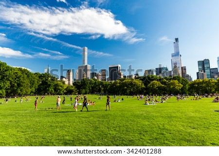 ?NEW YORK - AUGUST 22: Views of the from the big meadow Central Park to Midtown New York on August 22, 2015. The Central Park is a famous Park in the centre of Manhattan, New York. - stock photo