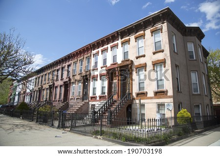 New York City brownstones in Bedford Stuyvesant neighborhood in Brooklyn - stock photo