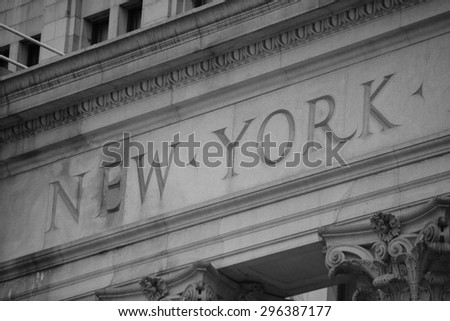 """New York"" engraved on a building in Lower Manhattan."