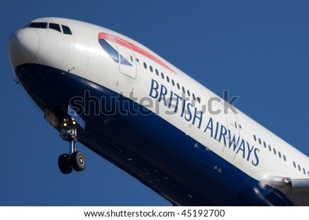 NEW YORK - JANUARY 6: A Boeing 777 British Airways arrives at JFK Airport on Runaway 31R on January 6, 2010 in New York. - stock photo