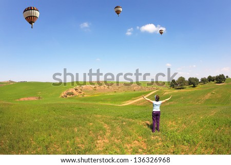 Nice elderly woman joyfully welcomed a flying balloon. The wonderful spring day