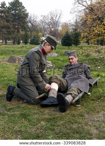 Nis, Serbia - November 14, 2015: Celebration of the Army of Serbia in Nis, images of soldiers in old uniforms from the great Serbian war - bandaging the wounded. - stock photo