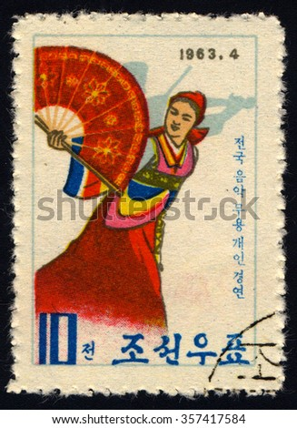 172 NORTH KOREA - CIRCA 1963: A stamp printed in North Korea shows International Music and Dancing Contest, Pyongyang, circa 1963