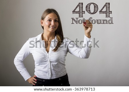 404 Not found - Beautiful girl writing on transparent surface - horizontal image