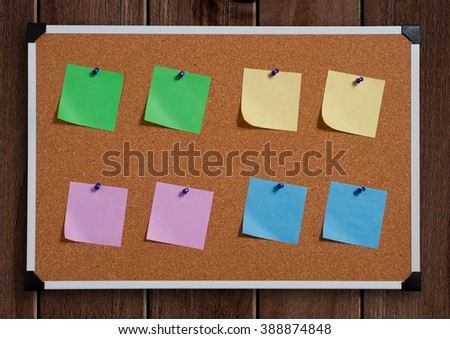 note papers on cork board - stock photo