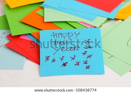 Note papers on white background,text happy new year