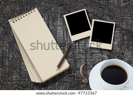 notebook and photo frame on background
