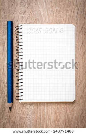Notebook with pencil and goals of year 2015 - stock photo