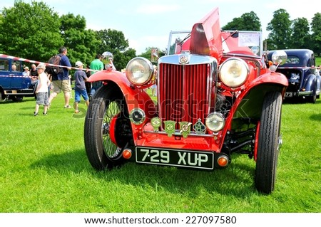 NOTTINGHAM, UK - JUNE 1, 2014: People admire of a rare MG vintage car for sale in Nottingham, England. - stock photo