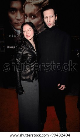 "17NOV99:  Rock star MARILYN MANSON & actress girlfriend ROSE McGOWAN at the world premiere, in Hollywood, of  ""Sleepy Hollow"" which stars Johnny Depp & Christina Ricci.  Paul Smith / Featureflash - stock photo"