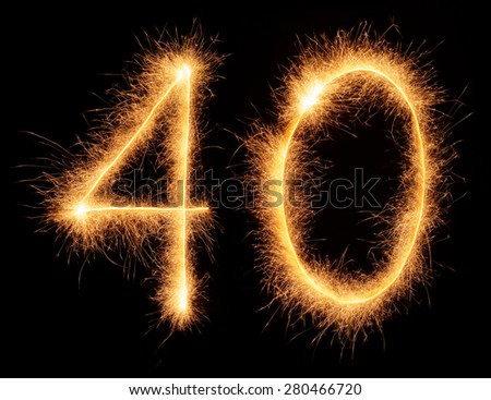 """40"" number drawn with bengali sparkles isolated on black background - stock photo"
