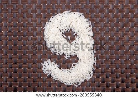 9, number from raw rice - stock photo
