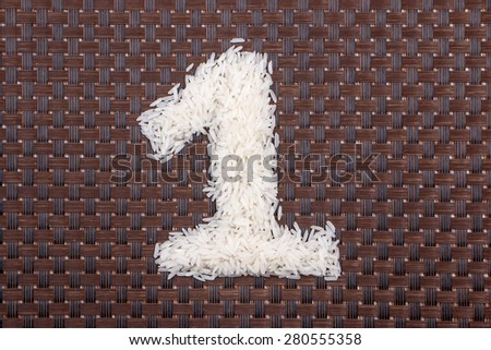 1, number from raw rice - stock photo