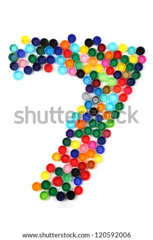 7 - number from the plastic caps isolated on the white background
