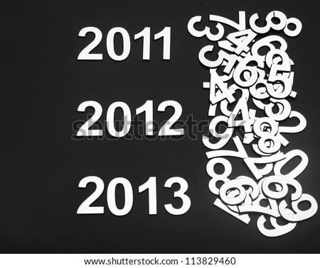 2013 number in surrounded by random metal numbers - stock photo