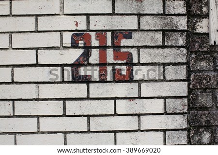 215 Number on Brick Wall