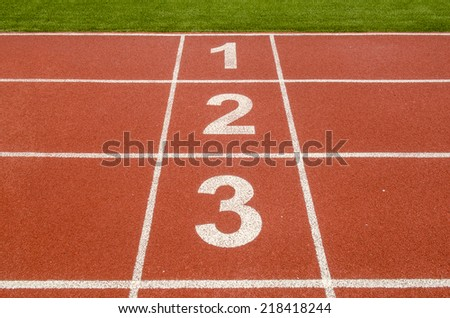 1 2 3 number on race track in football stadium. - stock photo