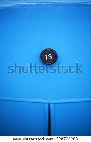 13, number thirteen, the serial number, seat in stadium - stock photo