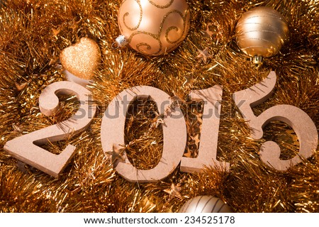 2015 numbers and christmas balls on background  - stock photo