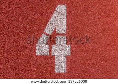 """""""4"""" Numbers on red running track - stock photo"""