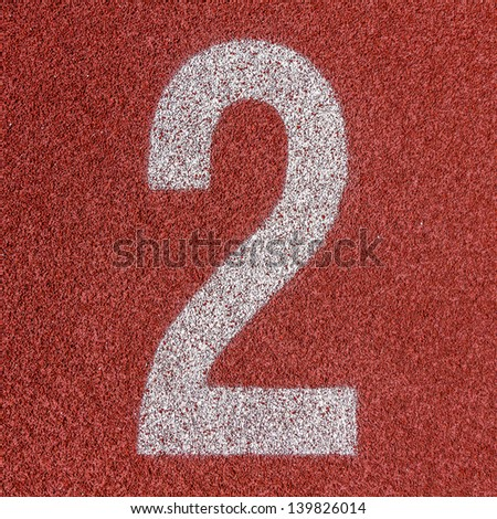 """""""2"""" Numbers on red running track - stock photo"""
