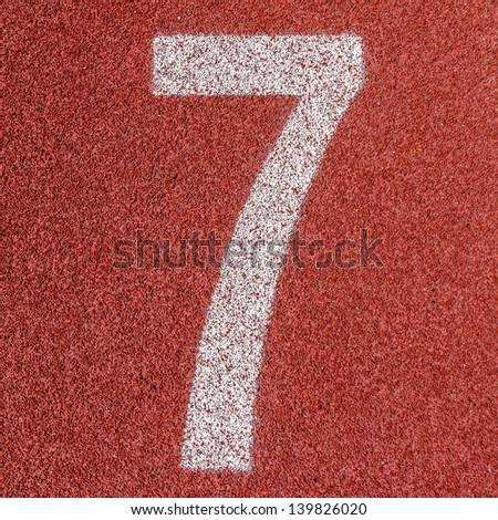 """""""7"""" Numbers on red running track - stock photo"""