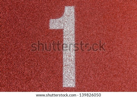 """1"" Numbers on red running track - stock photo"