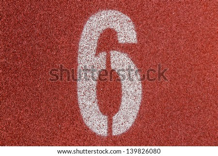 """""""6"""" Numbers on red running track - stock photo"""