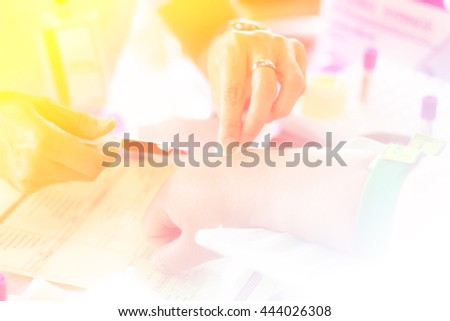 nurse pricked blood from a patient with color filters - stock photo