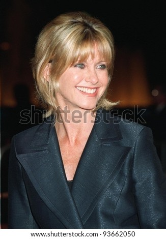 """27OCT97:  Actress/singer OLIVIA NEWTON JOHN at the premiere in Los Angeles of """"Mad City"""" which stars John Travolta & Dustin Hoffman. Olivia starred with Travolta in """"Grease"""" in 1978. - stock photo"""