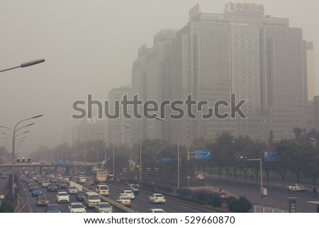 24 October,2014 - Beijing China. Air pollution in Beijing China city center,countless cars stuck on the road,the building beides are Sinopec(the China Petroleum and Chemical Corporation) and a bank