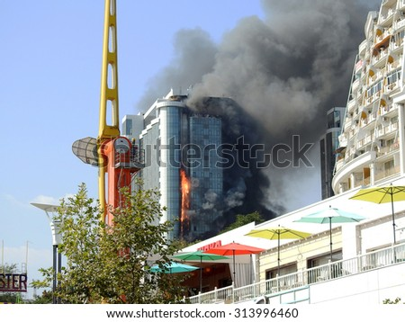 ODESSA, UKRAINE - 30 August 2015: The new construction skyscraper on fire. Violation of safety when building house. Extinguishing system is not working. Large losses of construction company.