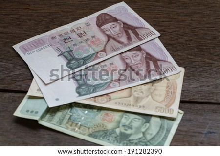 1000,5000 of Korea Won on old wooden - stock photo