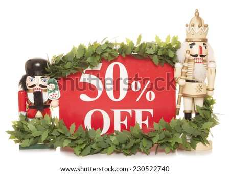 50% off christmas sale sign and nutcracker ornaments cutout - stock photo
