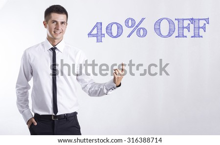 40% OFF - Young smiling businessman pointing on text