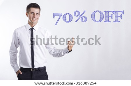 70% OFF - Young smiling businessman pointing on text
