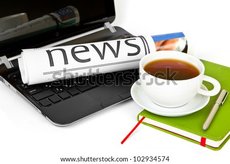 ?offee cup with laptop and newspaper - stock photo