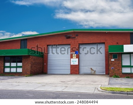 office building with warehouse closeup - stock photo