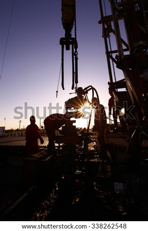 Oil drilling exploration, the oil workers are working - stock photo