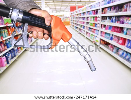 oil pump nozzle and supermarket background