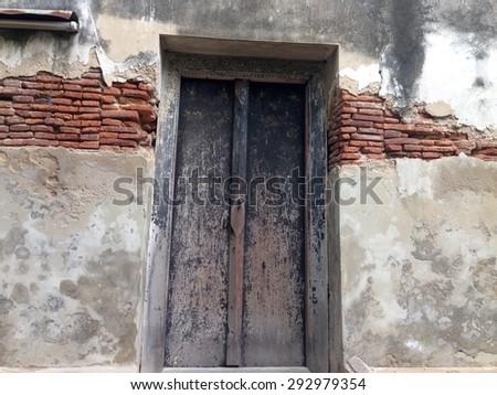 Old buddhist temple door  - stock photo