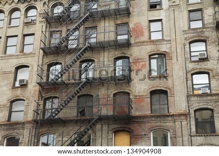 Old building with outdoor staircase (New York City, USA). Horizontally. - stock photo