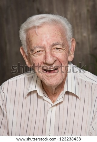 Old elder senior friendly man happy laughing portrait - stock photo