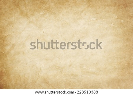 old  kraft paper texture or background with vignette borders  - stock photo