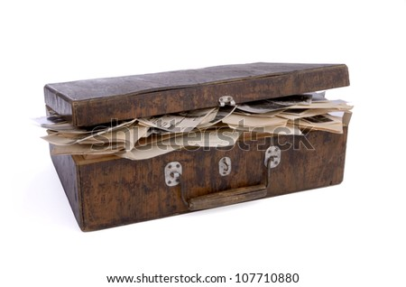 old nearly closed wooden box containing old photos, papers and documents, isolated on white background, isolated