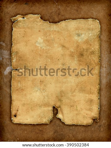old piece of worn-out fabric on a old bronze background - stock photo