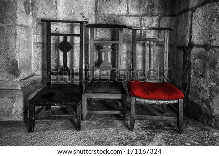 Old prayer chairs. Black and White (desaturated selective) - stock photo