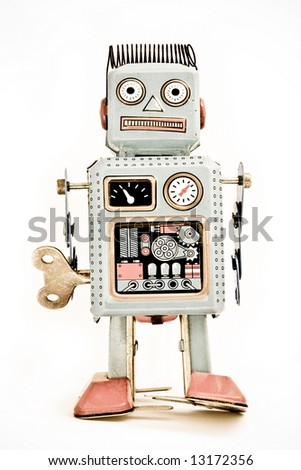 old robot toy  ( retro inspired image ) - stock photo