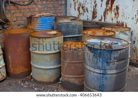 old rusty iron gray and blue barrels