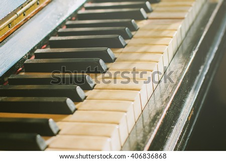 Old rusty piano keyboard, selective focus